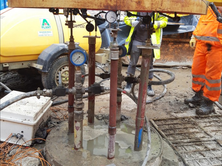 One of the base grouted columns is tested using the new extensometers alongside traditional strand anchors