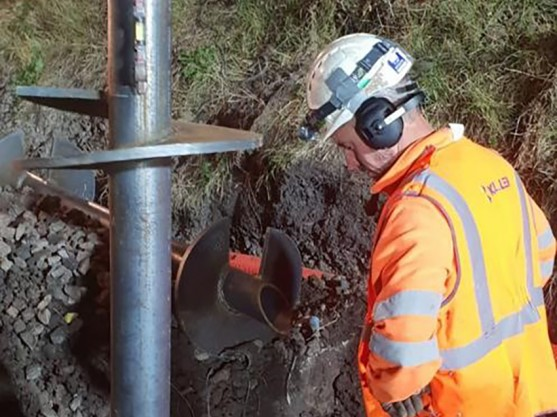 Engineer installing helical piles at Yarm station