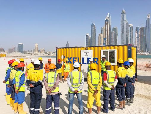 Keller site team at daily kick-off meeting on Dubai Harbour project