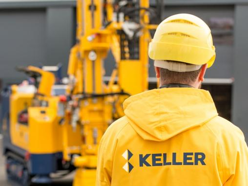 man in yellow jacket with keller logo on the back